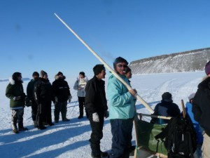 An inuit holds the tusk from a Narwhal whale in Greenland